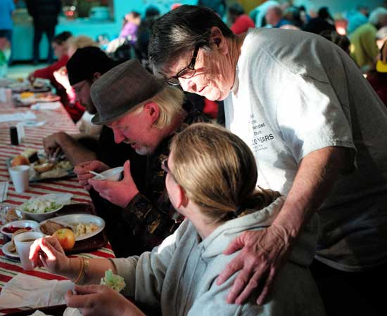 Maryland Food Bank network volunteer Pat has a conversation with a diner at her church's soup kitchen