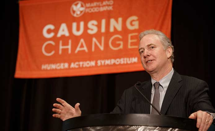 Senator Chris Van Hollen stands at podium
