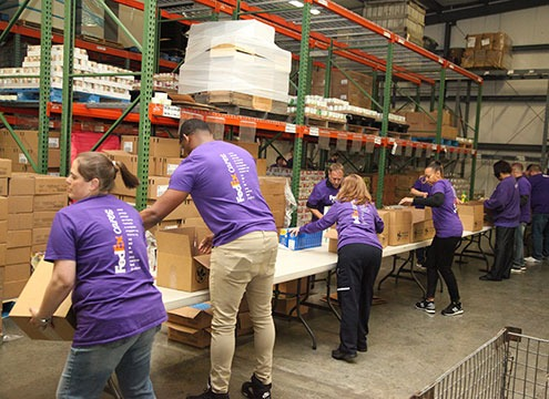 volunteers packing boxes in Hagerstown warehouse