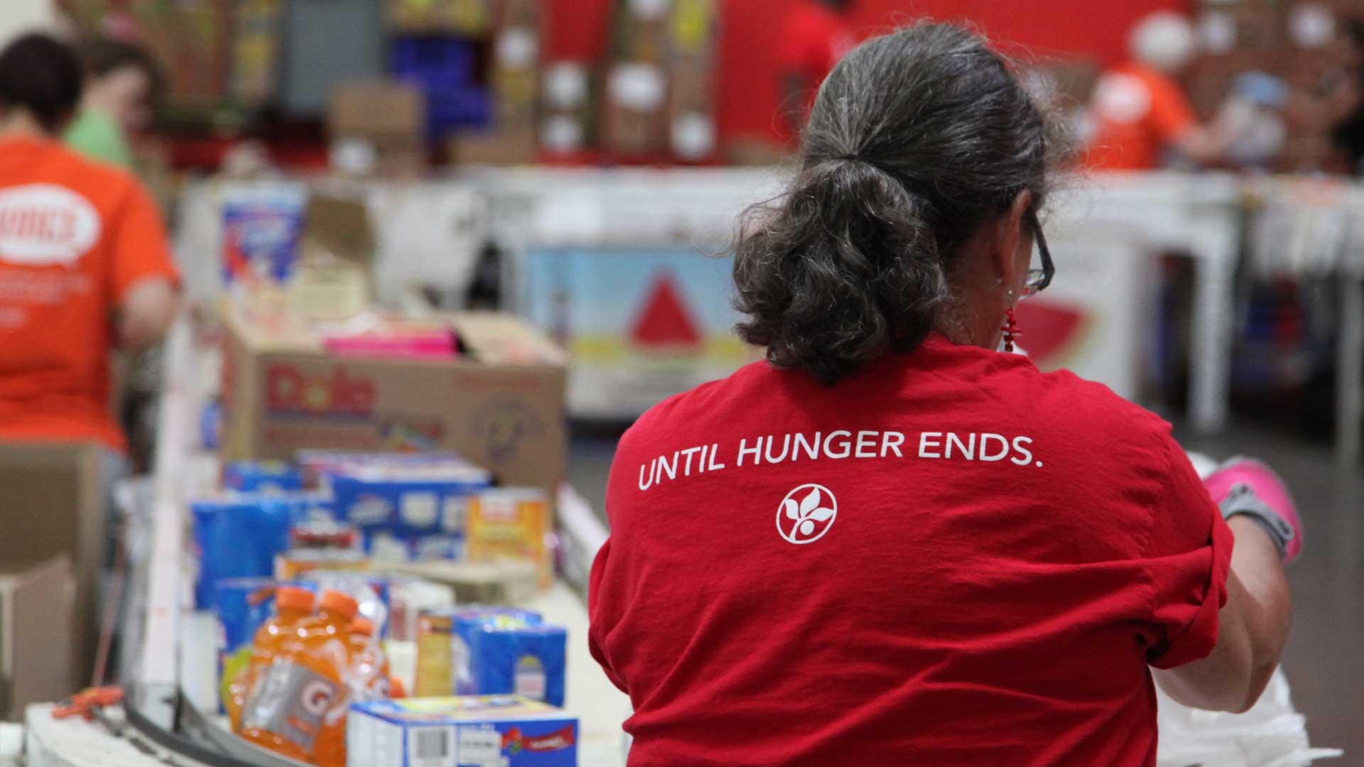 volunteer in an until hunger ends t-shirt