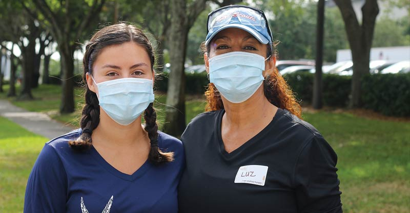 daughter and mother with masks