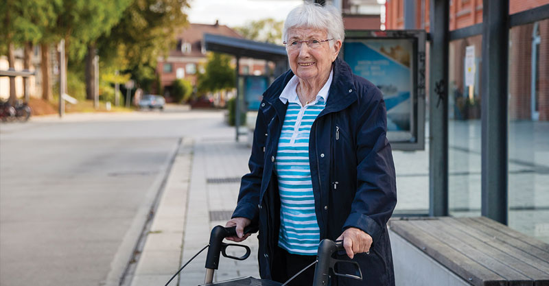 elderly lady with walker in the city