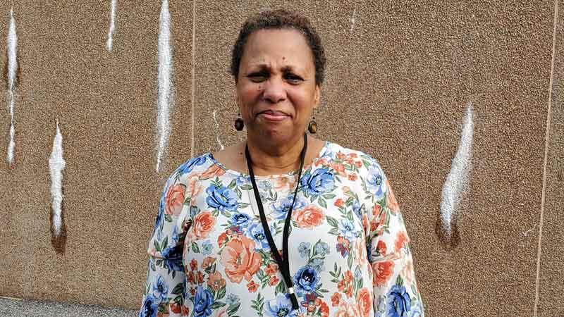Cheryl Beulah standing near wall