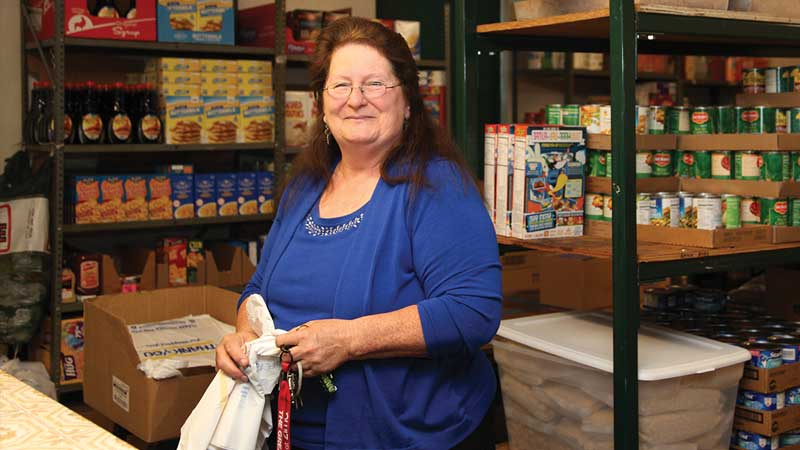 Marge Blum standing in food pantry