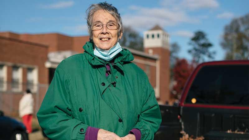 lady outside in green coat
