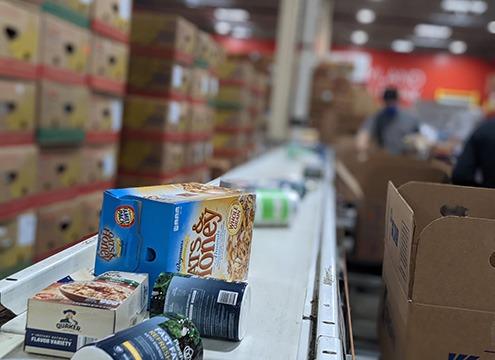 donated food on conveyor belt