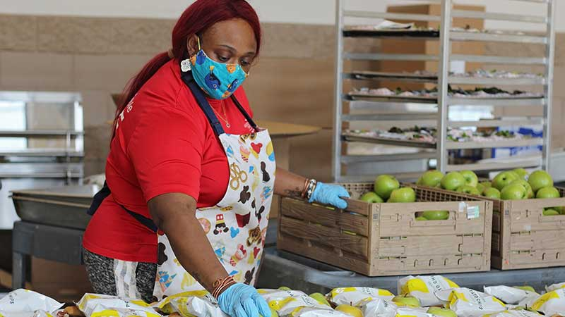 FoodWorks preparing lunches including apples
