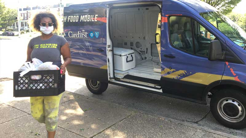woman delivers food mobile pantry